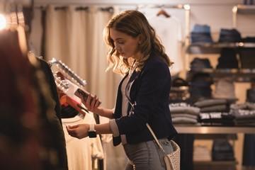 Beautiful woman looking at price tag