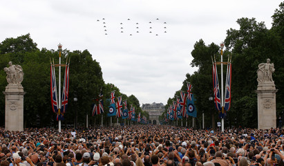 Military aircraft perform a fly past over the Mall and Buckingham Palace to mark the centenary of the Royal Air Force in central London