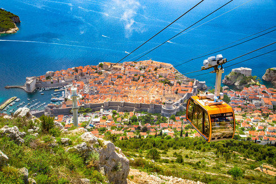 Old town of Dubrovnik with cable car ascending Srd mountain, Dalmatia, Croatia