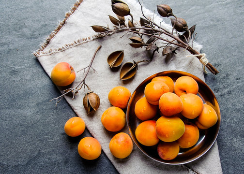 Apricots in a metal pial are stacked