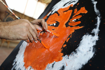 Egyptian speed painter Albert Magdy is seen while painting an inverted portrait of American actor Morgan Freeman in Cairo