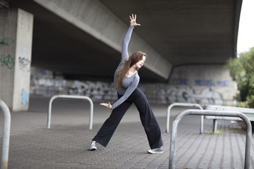 Modern Dancer in Motion on Sidewalk