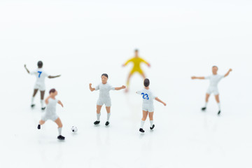 Miniature people : Football team image use for football of the year, world cup , sport concept.