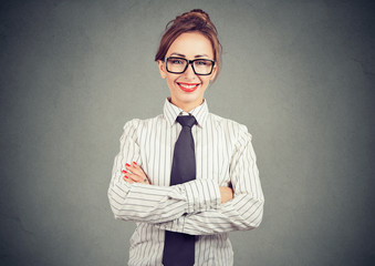 Elegant professional businesswoman in formal outfit smiling and looking at camera