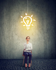 Smart businesswoman with light bulb above head