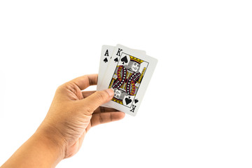 Poker spade in the hand of man isolated