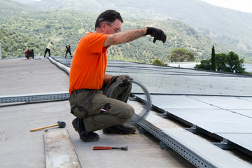 fitting photovoltaic panels on a roof