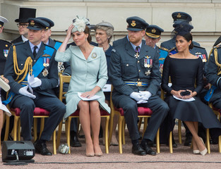 Members of the royal family watch as  Britain's Queen Elizabeth presents the RAF with new Queen's Colours to mark its centenary at Buckingham Palace, in London
