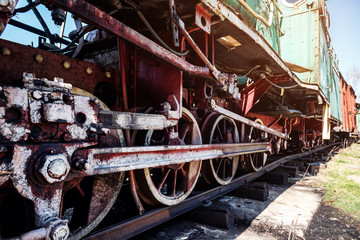 the wheels of the old locomotive