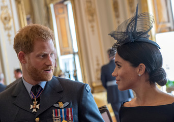 Britain's Prince Harry and Meghan, Duchess of Sussex attend a reception to mark the centenary of the RAF at Buckingham Palace, in London