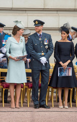 Britain's Catherine, Duchess of Cambridge, Prince Harry and Meghan, Duchess of Sussex watch as  Queen Elizabeth presents the RAF with new Queen's Colours to mark its centenary at Buckingham Palace, in London