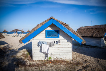 Blue and white painted hut in a sea resort.