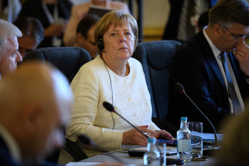 Germany's Chancellor Angela Merkel attends a plenary session during the Western Balkans Summit 2018 at Lancaster House in London