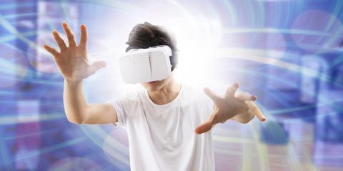 young man enjoying virtual reality glasses