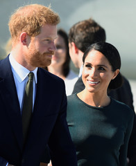 Britain's Prince Harry and his wife Meghan, the Duke and Duchess of Sussex, arrive at the airport for a two-day visit to Dublin