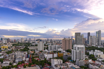 cityscape Bangkok sunset skyline, Thailand. Bangkok is metropolis and favorite of tourists live at between modern building / skyscraper, Community residents