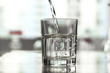 Water is poured into a glass.
