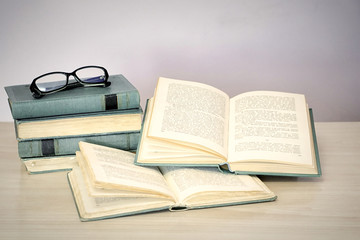 Education and reading concept - group of books on the wooden table
