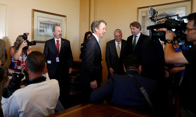 U.S. Supreme Court nominee Kavanaugh makes his way through press at meeting on Capitol Hill in Washington