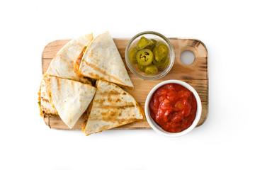 Mexican quesadilla with chicken, cheese and peppers, isolated on white background. Top view