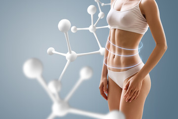 Woman with perfect body near molecule chain.