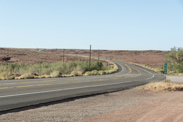 Solitary desert highway. Old asphalt road in a hot location