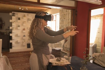Female potter using virtual reality headset