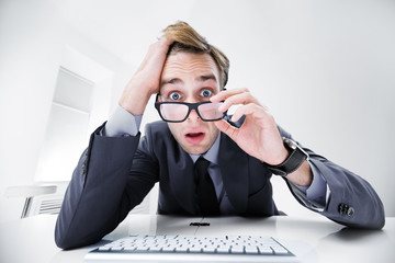 Businessman using computer, at office