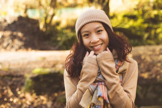 Beautiful woman in warm clothing during autumn