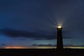 Panoramic View of San Roman Lighthouse at night with stars in Venezuela
