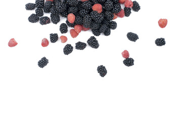 Placer black blackberry and red raspberries on white isolated background.Top view and copy space.