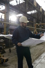 Technician looking at blue print