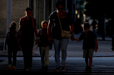 Children are escorted to the Cayuga Center, which provides foster care and other services to immigrant children separated from their families, in New York