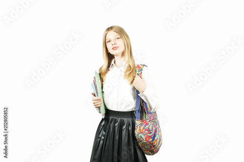 084281e77c Beautiful blonde teenage girl with charming smile in schoolgirl uniform  wearing pleated skirt, white shirt, backpack, holding notebooks. Back to  school sale ...