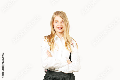 0db4a41ba7 Beautiful blonde teenage girl with charming smile in schoolgirl uniform  wearing pleated skirt, white shirt, backpack, hands crossed. Back to school  sale ...
