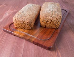 Freshly baked bread on dark gray kitchen table