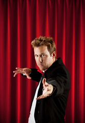 Magician: Man Gesturing to Audience