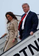 U.S. President Donald Trump and first lady Melania Trump arrive aboard Air Force One ahead of the NATO Summit, at Brussels Military Airport in Melsbroek