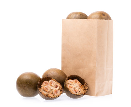 bag paper of arhat fruit isolated on white background