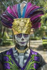 Pre-Hispanic Catrina costume. Elegant skull make-up portrait made in Mexico