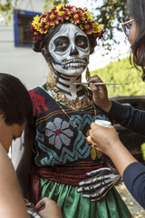 Traditional clothing and make-up for the Day of the dead. Getting ready for the death celebration in Mexico