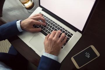 Businessman using laptop in hotel