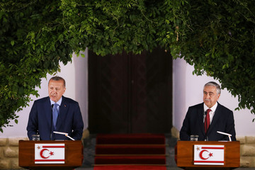 Turkish President Tayyip Erdogan and Turkish Cypriot leader Mustafa Akinci talk at a press conference during a visit in the Turkish Cypriot northern part of the divided city of Nicosia