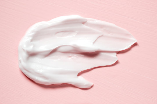 Smear of natural moisturizer in pink background. Cream, Lotion for face or body. Skin care.