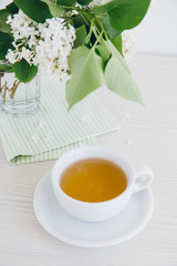 Cup of green tea on a white table