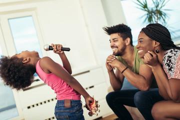Black family enjoy singing karaoke