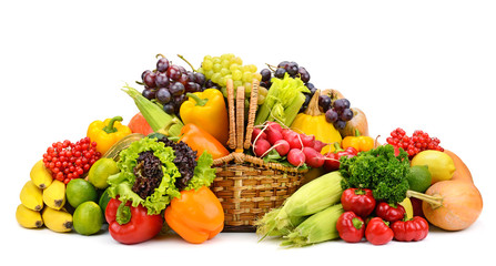 Healthy fresh vegetables and fruits in willow basket isolated on white background.