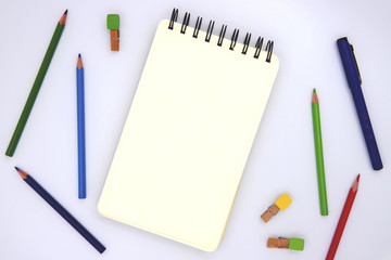 Blank page of sketching pad with crayon on white, top view photo. Children art class or education banner background
