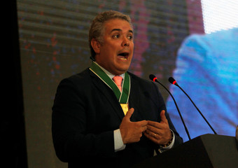 Colombia's President-elect Ivan Duque, speaks after being condecorated, in Medellin