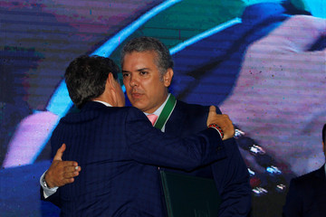 "Colombia's President-elect Ivan Duque is decorated by the governor of Antioquia, Luis Perez with the ""Escudo de Antioquia, Oro category"", in Medellin"